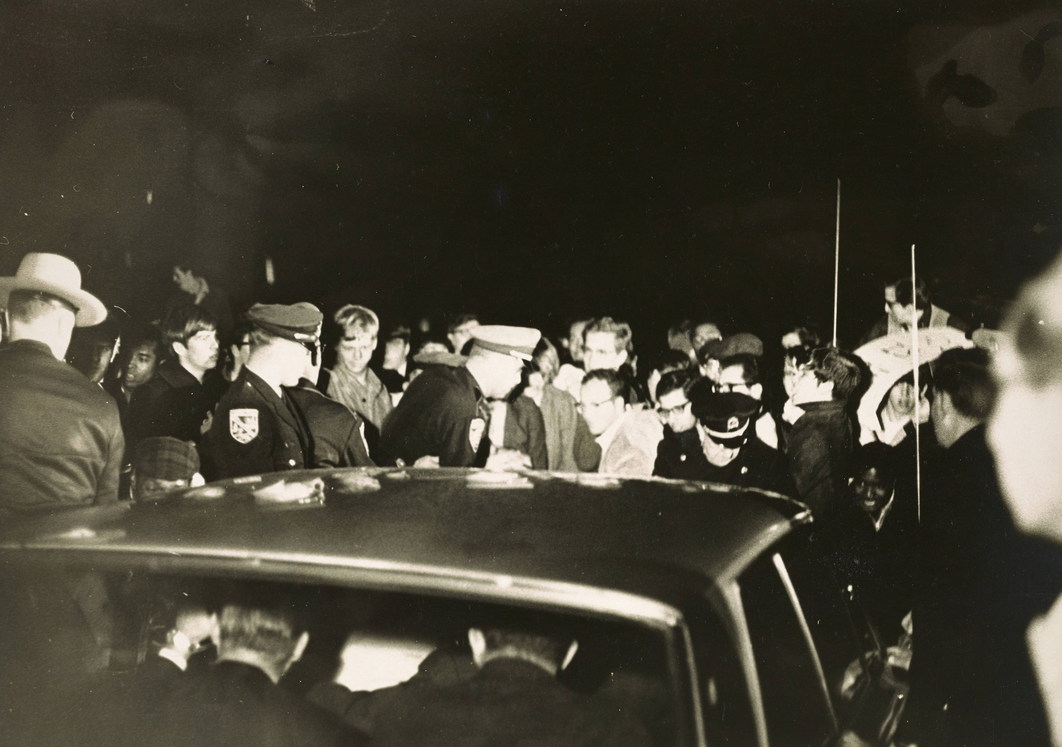 Students surround the car of George Wallace, 1967