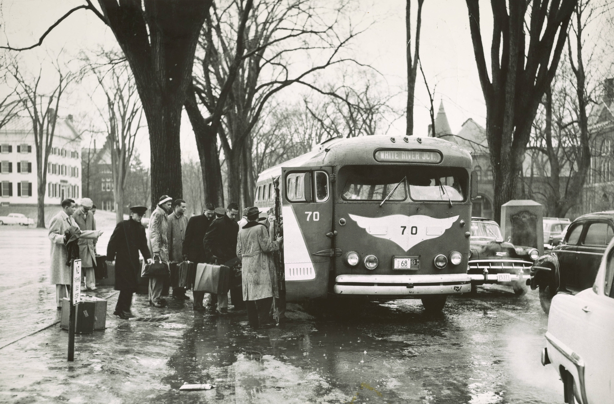 Men catch a bus to White River Junction