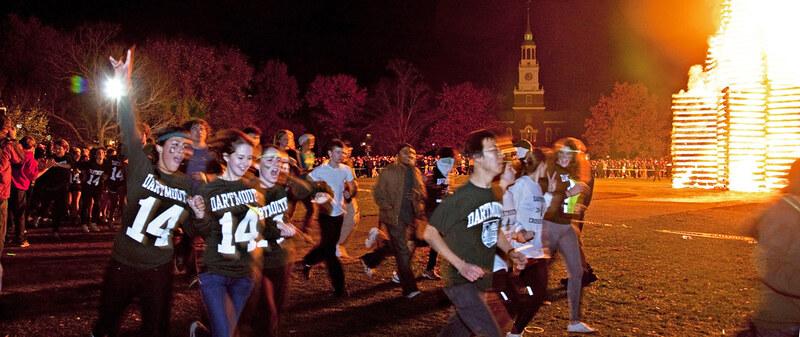 Class of 2014 runs around the bonfire on Dartmouth Night