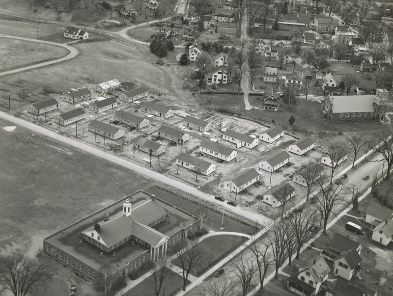 An aerial view showing Federal Housing Authority (FHA) approved temporary housing for student veterans in Sachem Village.