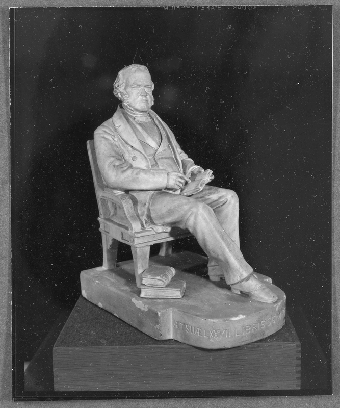 "Statuette of George Ticknor by Martin Milmore, 1868. The Latin inscription on its base means: ""[George Ticknor in] his 77th year. Always with his beloved books."" https://hoodmuseum.dartmouth.edu/objects/s.x.465"