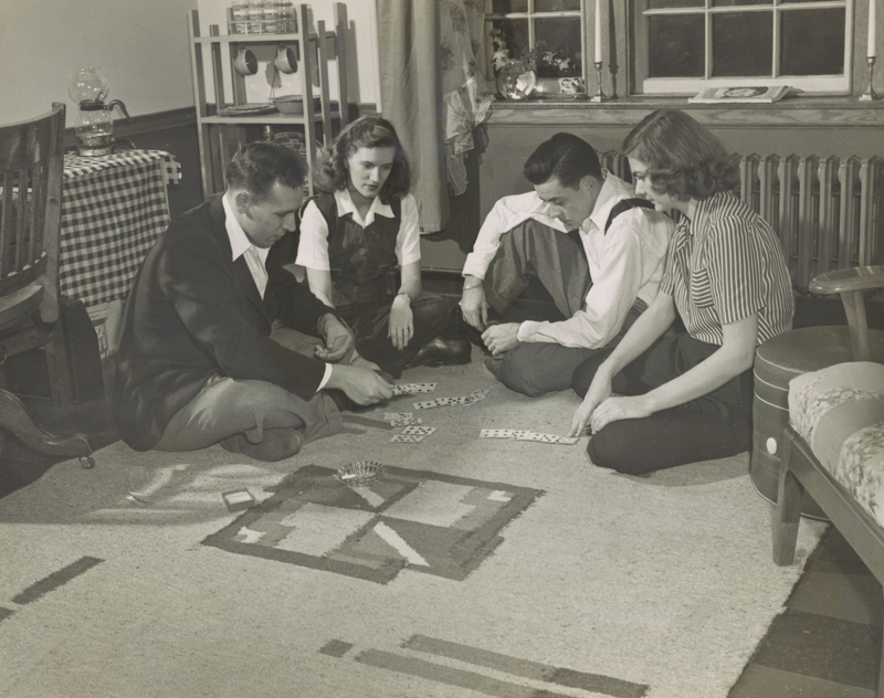 Two married veterans and their wives at Dartmouth College take time off from studies for a game of cards in one of the dormitory apartments created by the college for the married students. The couples are (left) Mr. and Mrs. Bynum E. Hinton Jr. '42 of Washington, D.C., and Mr. and Mrs. Robert K. Schoonmaker '42 of Toronto, B.C., Canada.