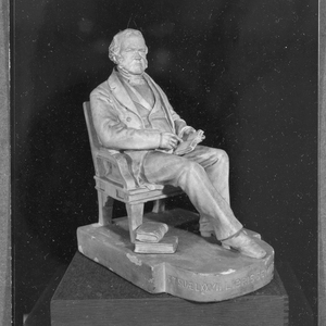 """Statuette of George Ticknor by Martin Milmore, 1868. The Latin inscription on its base means: """"[George Ticknor in] his 77th year. Always with his beloved books."""" https://hoodmuseum.dartmouth.edu/objects/s.x.465"""